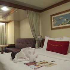 Deluxe family w/veranda. Qn bed, sofa bed, bunk over sofa, Murphy bed beyond