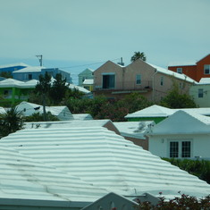 All roofs must be white, by law. Constructed this way to catch rain water.
