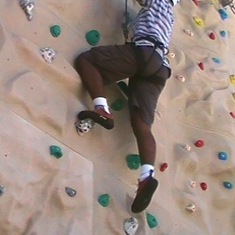Up I go, climbing the rock-wall on-board