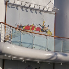 Huge picture of goofy diving-- but there is no diving allowed on board.