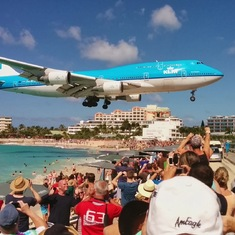 Plane landing at Maho Beach on St. Maarten.