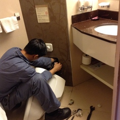 toilet valve being replaced after it overflowed