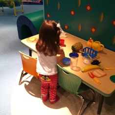 """My niece playing in the """"It's a Small World"""" playroom."""