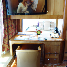 Work Desk with window over looking balcony on the Pinnacle Suite, Cabin 7001