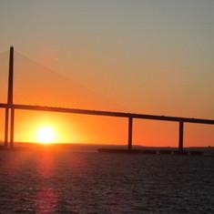 Sunset going under Tampa Bay Bridge