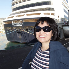 My wife in front of our ship, ms Rotterdam, docked in Funchal (Madeira),