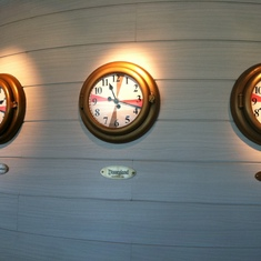 Clocks showing times at theme parks in Cabanas on Disney Dream