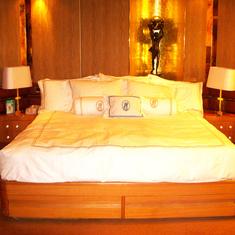 Bed in Pinnacle Suite, Cabin 7001 taken Feb 2012 before Dry Dock.  Logos