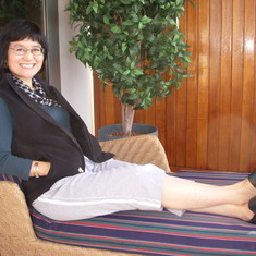 Relaxing on lounge chair on Penthouse Suite Balcony, Westerdam