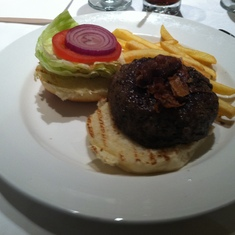 A burger in the main dining room on Royal Princess