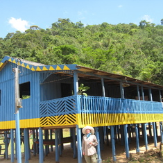 Typical village home, lots of ventilation, top of stilts mark high water