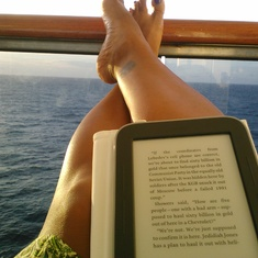 Enjoy my first balcony with good book.